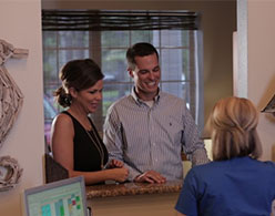 photo of patients getting information at the front desk
