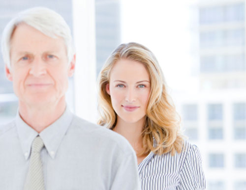 photo of professional looking man and woman, who could be candidates for dental implants