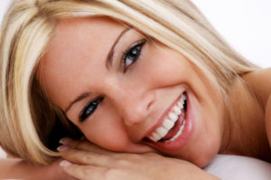 photo of woman smiling after teeth whitening