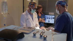 large photo of staff performing dental procedure